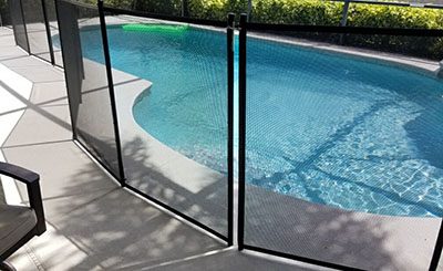 jacksonville pool safety fence installed around patio pool