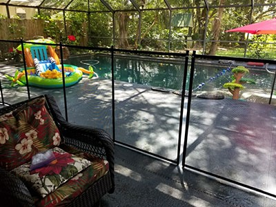safety fence for pool installed to keep toddlers out